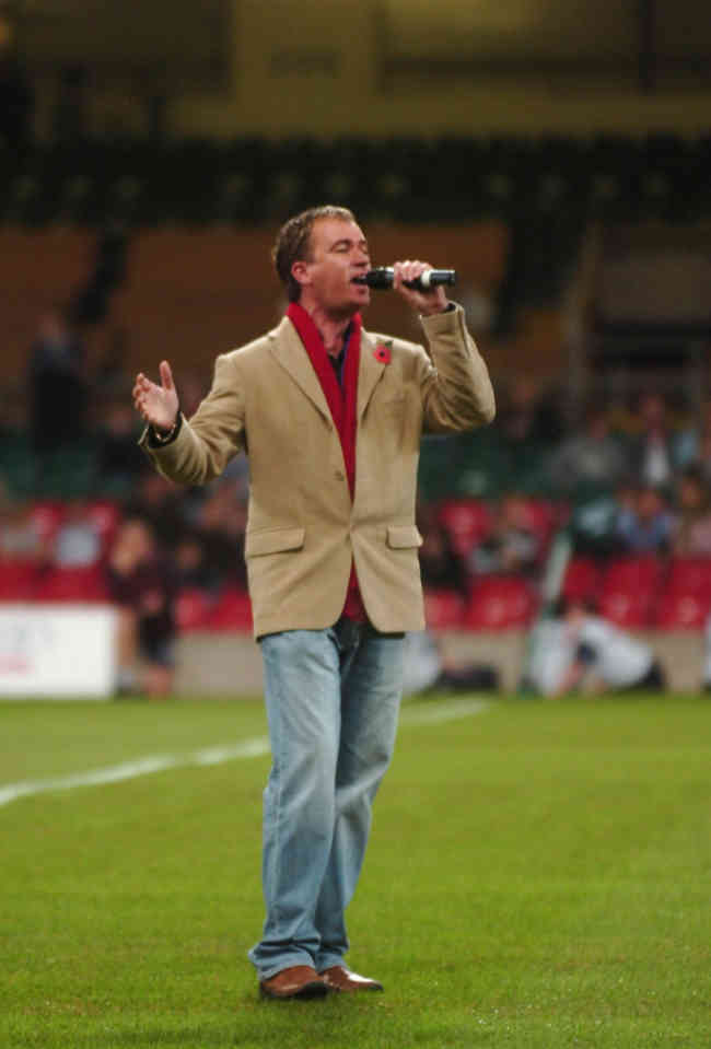 Paul Child singing Welsh national anthem before rugby game at Millenium Stadium, Cardiff Wales;